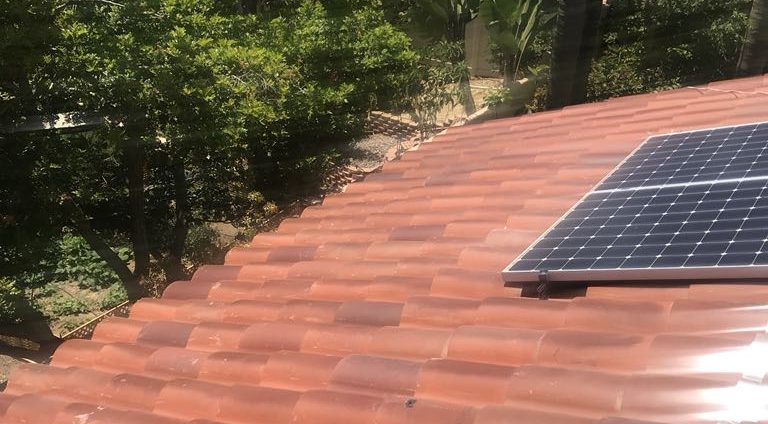 Clay Tile Repairs Under a Carlsbad Home's Solar System
