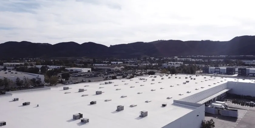 Large warehouse in Temecula, CA coated with high solids silicone by Level 1 Roofing