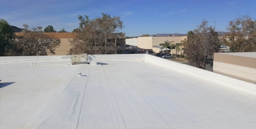 Commercial Roofing Restoration in Temecula, CA – Silicone Coating on Warehouse